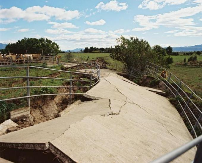 This cow shed off-ramp on McCracken Road was badly damaged in the earthquake. [GNS Science]