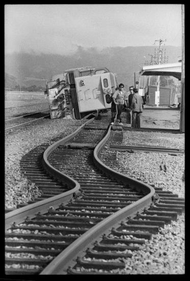 Railway lines and a locomotive affected by the Edgecumbe earthquake. [Ref #: EP/1987/0990/9 Part of The Dominion Post: Photographic negatives and prints of the Evening Post and Dominion newspapers (PAColl-7327) and (EP/1987/0990)]