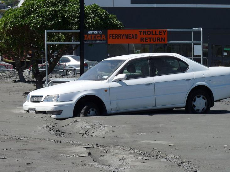 Car trapped by liquefaction in Ferrymead, Christchurch. [GNS Science]
