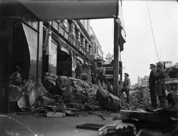 Shop fronts in Masterton, damaged by the earthquake. 25 June 1942 [Ref #: 1/2-123912-G Part of: Evening Post: Photographic negatives and prints of the Evening Post newspaper (PAColl-0614) Part of: Negatives of the Evening Post newspaper (PAColl-0614-1)]