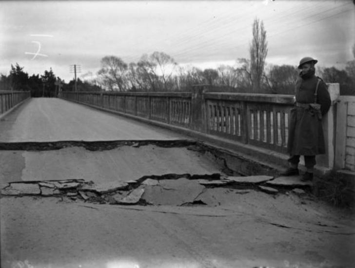 Damage to the Waiohine bridge after the 1942 Masterton earthquake. 25 June 1942 [Ref #: 1/2-123915-G Part of: Photographic negatives and prints of the Evening Post newspaper (PAColl-0614) and Negatives of the Evening Post newspaper (PAColl-0614-1)]
