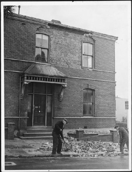 Brick house damaged by earthquake, Wellington. August 1942. [Ref #: EP-Science-Earthquakes-1940s-and-1950s-05 Part of: The Dominion Post: Photographic negatives and prints of the Evening Post and Dominion newspapers (PAColl-7327)]