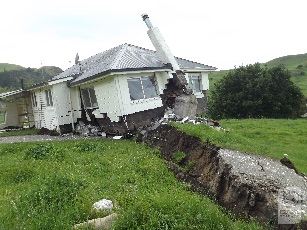 Bluff station. Kekerengu Fault rupture displacing the road and house by ~10 metres. Photo by Tim Little
