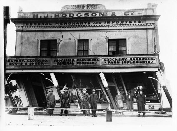 Earthquake-damaged business premises of H. J. Hodgson & Co. in Murchison, 1929. [Jones, Frederick Nelson, 1881-1962. Ref #: 1/2-026346-G Part of: Negatives of the Nelson district (PAColl-3051)]