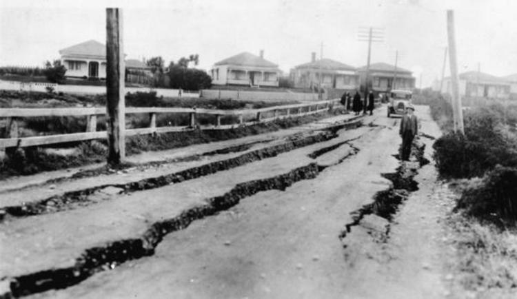 Cracks in a road in Greymouth, after the 1929 Murchison earthquake, 1929. [Ref #: 1/2-091674-F Part of: West Coast Historical and Mechanical Society: Photographs (PAColl-5376)]