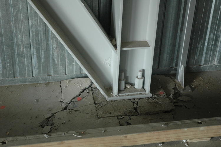 Foundation uplift inside a brand-new 5-storey building on very soft soil adjacent to the Turanganui River. The resulting tilting of the structural frame above the foundation, possibly exacerbated by a design flaw, caused serious damage to the building.