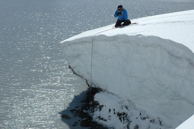 Scientists collecting crater lake samples.